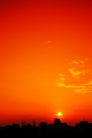 silhouette of urban skyline isolated on orange sunset view Stock Photo