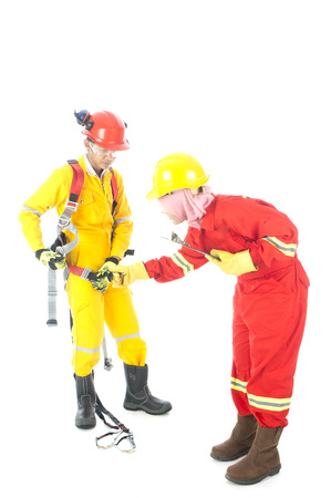 A woman teaching how to wear safety body harness properly