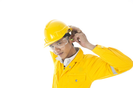 A man demonstrate how to wear ear plug properly