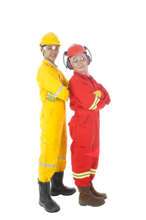 personal protective equipment: Man and woman standing complete with personal protective equipment