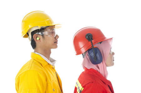Man and woman worker show the type of ear proctection Stock Photo