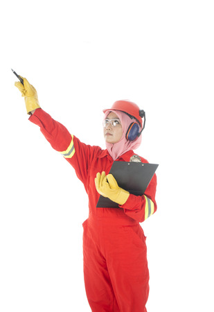 A woman complete with personal protective equipment at work site  Stock Photo