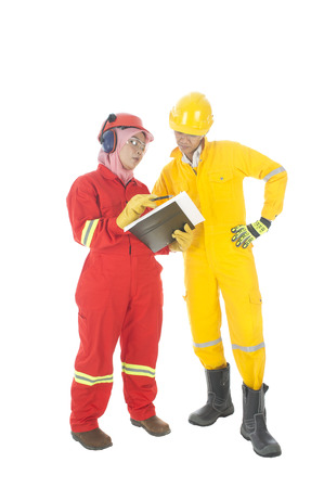 personal protective equipment: Man and women worker complete with personal protective equipment discussing their work problem Stock Photo