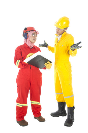 personal protective equipment: Man and women worker with personal protective equipment discussing their work problem