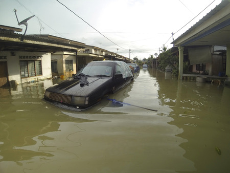 worst: KUANTAN, PAHANG, MALAYSIA-DEC 05:Unidentified of condition a submerged vehicle after strucked the worst floods in history