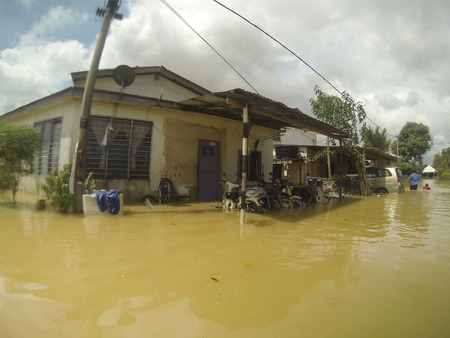 worst: KUANTAN, PAHANG MALAYSIA-DEC 05:Unidentified of condition house after strucked by the worst floods in history