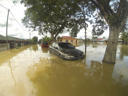 the worst: KUANTAN, PAHANG, MALAYSIA-DEC 05:Unidentified of condition a submerged vehicle after strucked by the worst floods in history
