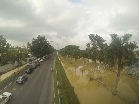 inundated: KUANTAN, PAHANG MALAYSIA-DEC 05:View from the bridge shows some low areas inundated by the worst floods in history Editorial