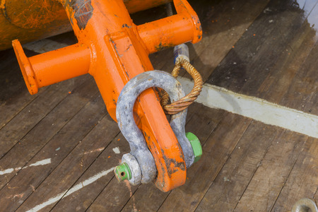 eye pad: Industrial equipment. A heavy weight shackle with rusty wire ropes attached to pad eye buoyancy tank for anchor handling activities. Stock Photo