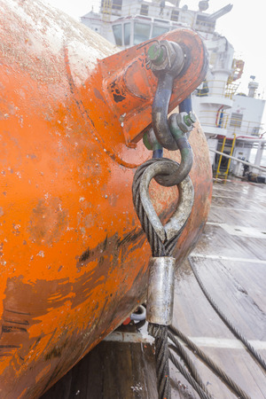 eye pad: Industrial equipment. A heavy weight shackle with wire ropes attached to pad eye buoyancy tank for anchor handling activities.