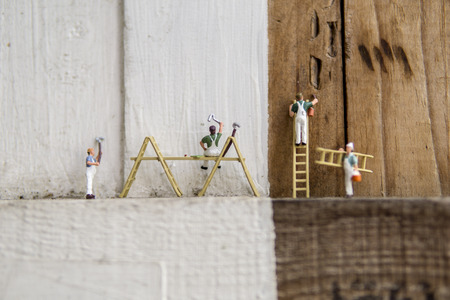 Miniature figures painting - Teamwork cleaning concept with selective focus.