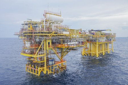 Oil and gas industry. View of oil and gas drilling platform in open sea.