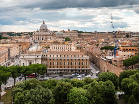 st  peter's basilica pope: A wide shot of The Vatican City and St. Peters Basilica cathedral with the epic dome.