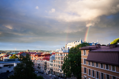 gothenburg: An amazing and colorful rainbow has formed over the city center of Gothenburg, Sweden. The street is Vastergatan in the Vasastan district central Gothenburg. Wonders of nature. Stock Photo