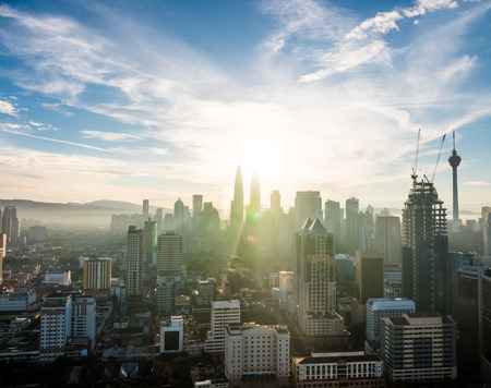 twin tower: View of the amazing Kuala Lumpur skyline with the Petronas Towers in Malaysia at sunrise  dawn. Stock Photo