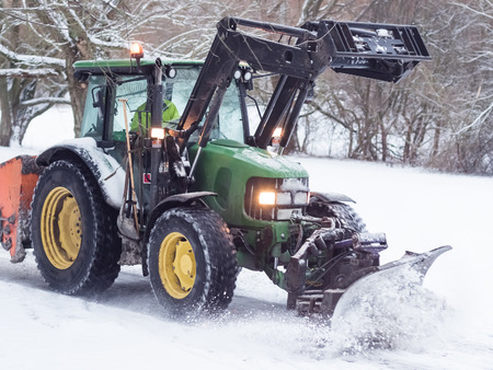 snow plow: A snow plow in action removing snow from a road in southern Sweden after heavy snowfall. Stock Photo
