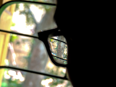 big brother spy: Looking through lens or goggles