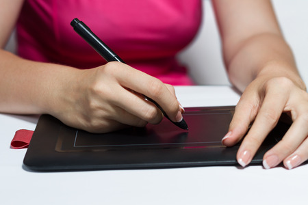 french manicure: Woman With French Manicure Painting With Black Graphic Tablet
