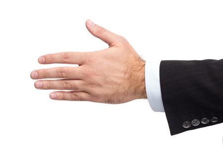 traje formal: Mano Masculina En Un Traje De Negocios Da La Mano Foto de archivo