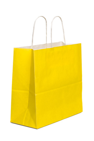 yellow paper: Yellow Paper Shopping Bag On White Background Stock Photo