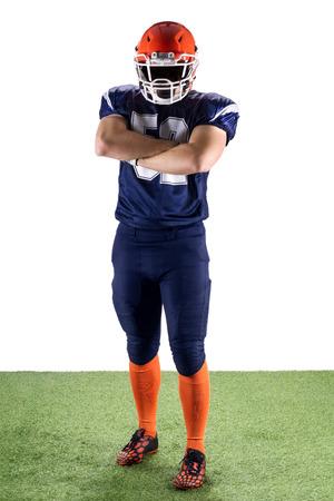uniforme de futbol: Jugador de fútbol americano Mantener los brazos cruzados