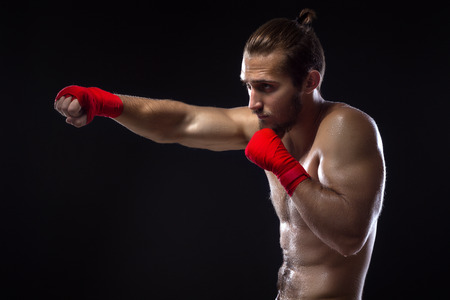 kickboxing: MMA Fighter Practicing Some Kicks