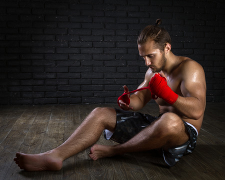kickboxing: MMA Fighter Preparing Bandages For Training
