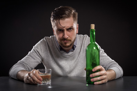 sacked: Sacked Manager With Bottle Stock Photo