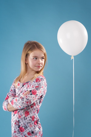 Little Girl With Ballon On Blue Background Stock Photo