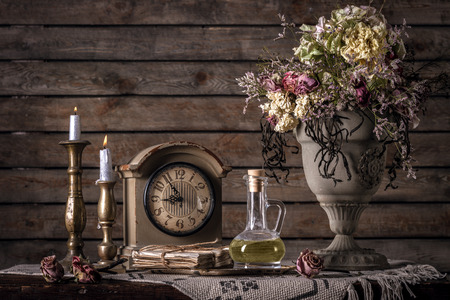living style: Vintage Still Life With Flowers, Clock,  Letters, And Candles