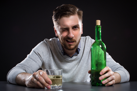 man hair: Drunk Man With Bottle On Black Background