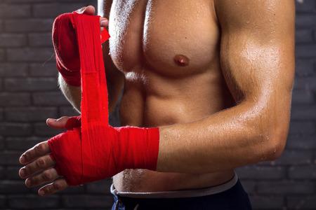 thai arts: MMA Fighter Preparing Bandages For Training