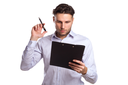 clothes organizer: Pensive Young Businessman Holding A Tablet And Pen Isolated On White Background. Business Theme