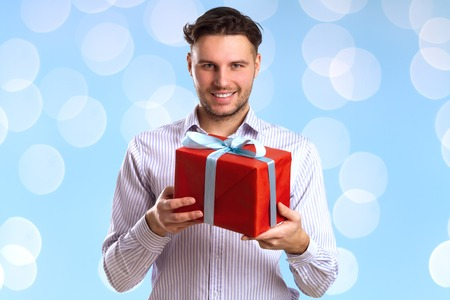 cardboard only: Man With Red Gift Box Isolated On Blue Background