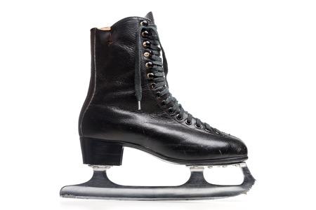 iceskates: Old Black Figure Ice Skate Isolated On White Background