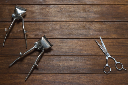 hair clippers: Two Old Vintage Manual Metal Hair Clippers And Scissors On Wooden Table Stock Photo