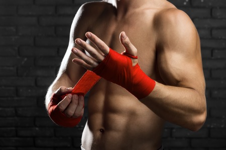 mixed martial arts: Mixed Martial Arts Fighter Preparing Bandages For Training Stock Photo