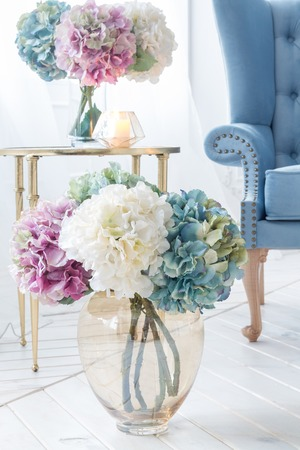 contemporary living room: Beautiful Provance Living Room With Flowers Near Blue Sofa