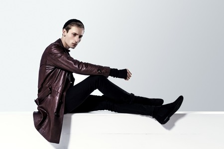 black sweater: Handsome Fashion Man In Brown Leather Coat