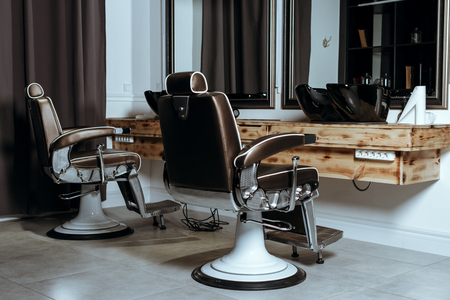 Stylish Vintage Barber Chairs In Wooden Interior. Barbershop Theme