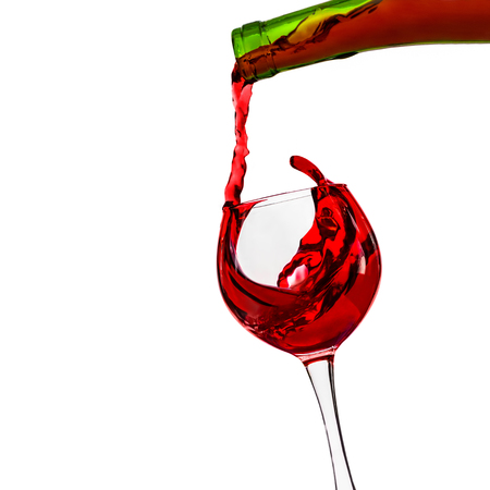 Red Wine Pours With A Splash From The Bottle Into The Glass