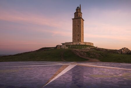 Hercules lighthouse tower in A Coruna at sunset Stock Photo