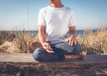 brain aging: Man sitting in Yoga Pose. Stock Photo