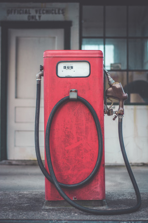 old buildings: Old fashioned fuel pump. Stock Photo