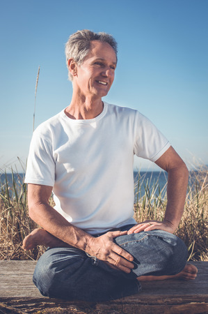 brain aging: Man Sitting in Yoga Pose