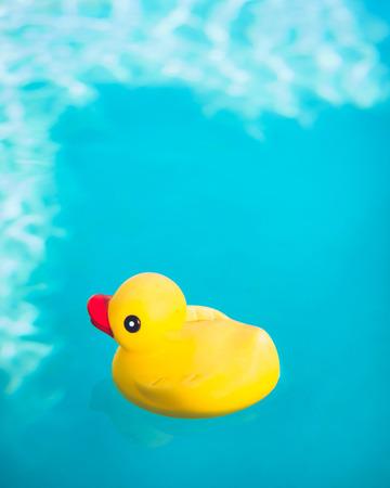 rubber ducky: Rubber Ducky floating in deep blue water.