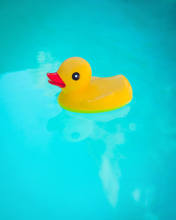ducky: Rubber Ducky floating in deep blue water.