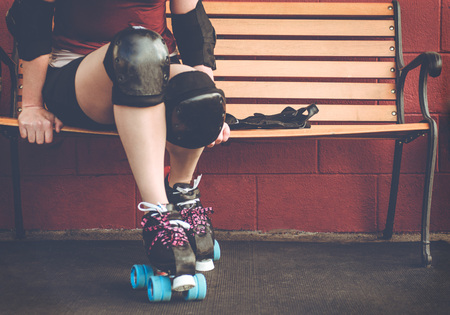 Woman on roller skates outside of a roller rink. Stock Photo