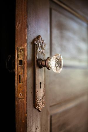 ornate door: An old door, open with an ornate door knob.