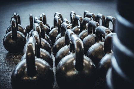 put away: Kettlebells organized and put away at the gym. Stock Photo